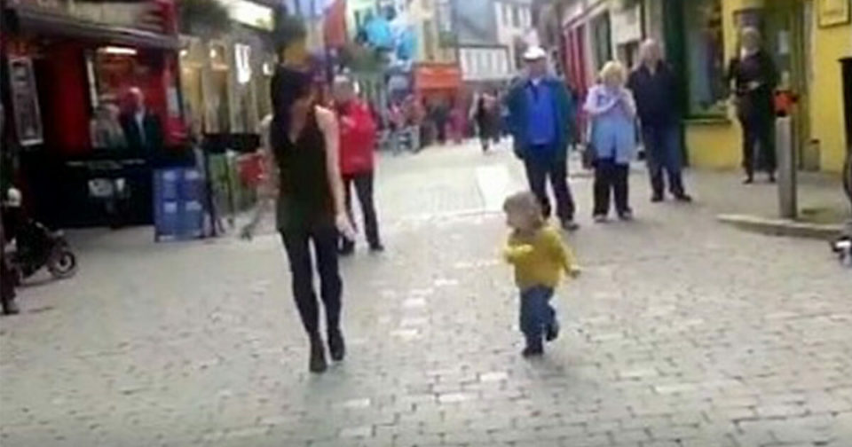 Tiny little girl interrupts dancer on the street and goes viral with her adorable moves