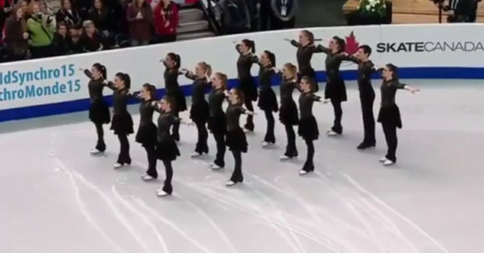 Skaters hold their ground in formation, only to move their feet and have everyone lose it
