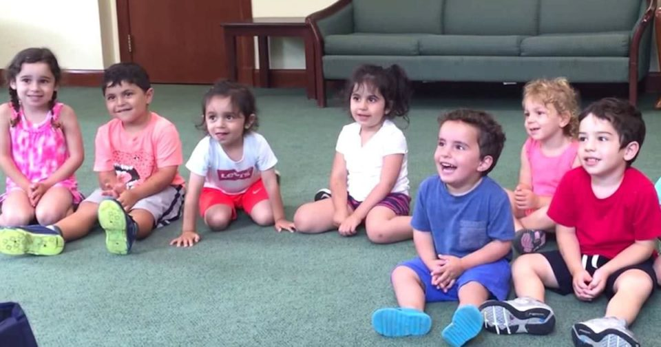 Teacher tells her students to clap their hands, only pay attention to a little boy in blue