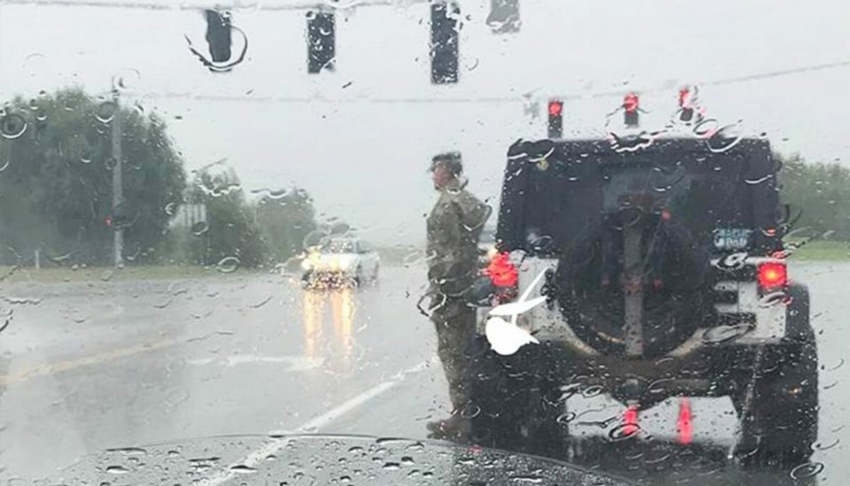 Let's pay tribute to the US soldier snapped standing to attention in the pouring rain for e stranger 's funeral