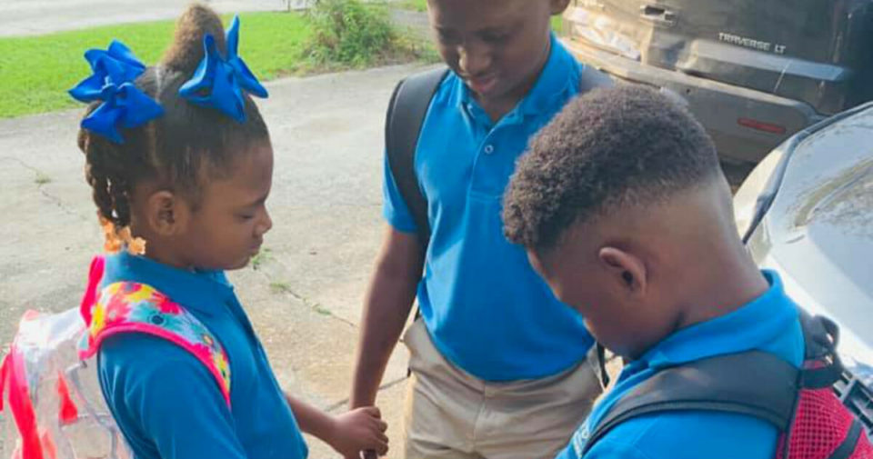 First day of school photo of siblings praying goes viral- may God bless and protect these beautiful children!