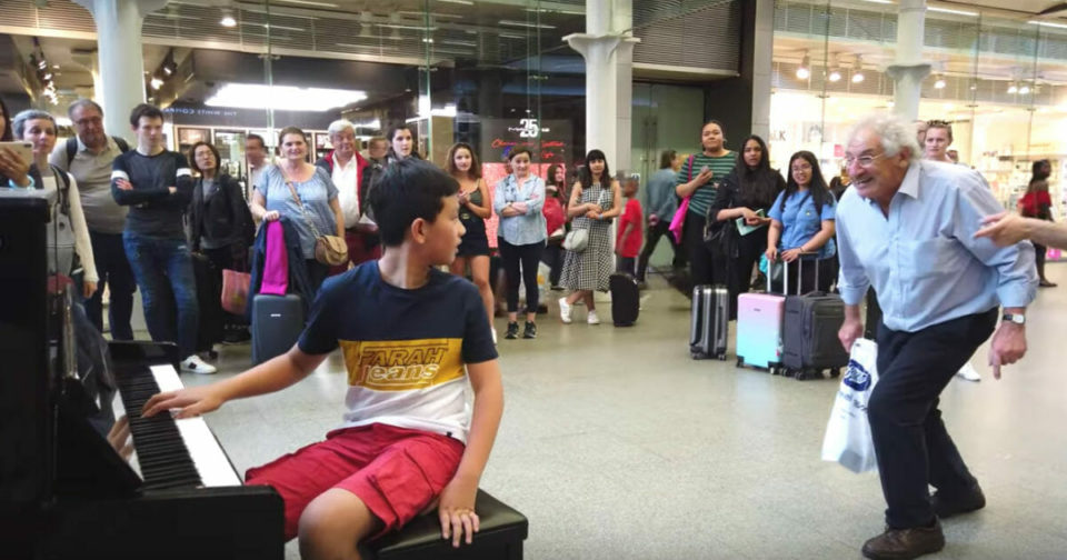 Two shoppers interrupt young boy on piano to request he play 'Bohemian Rhapsody'