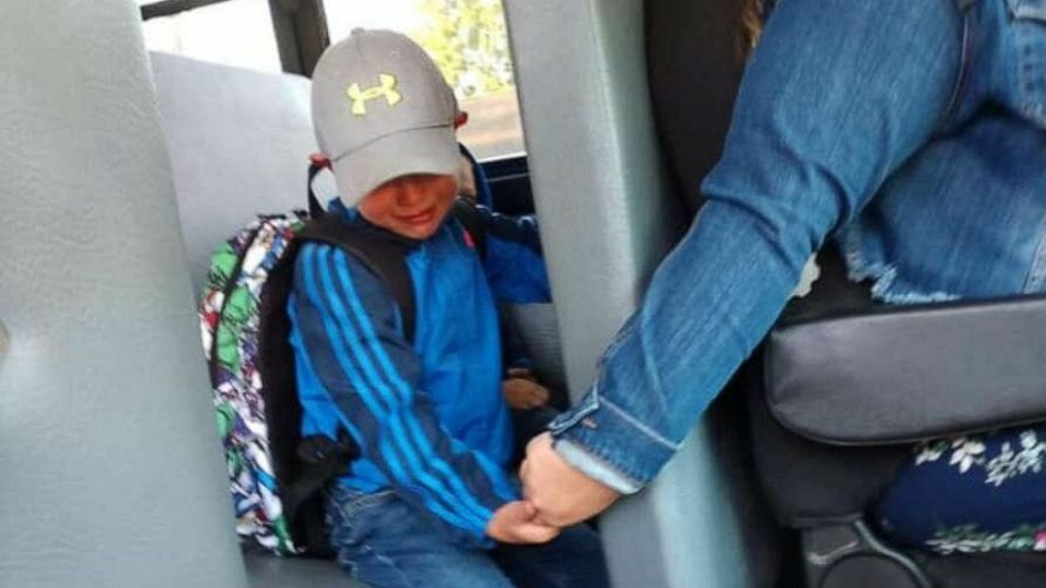Bus driver holds nervous 4-year-old boy's hand on his first day of school – help us pay tribute