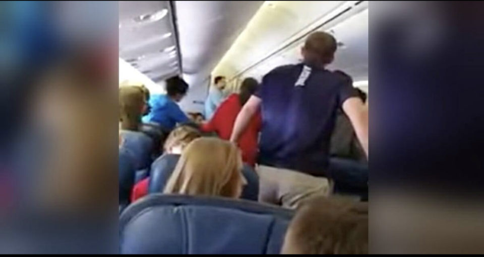 High school choir start to sing as soldier's remains are carried off plane