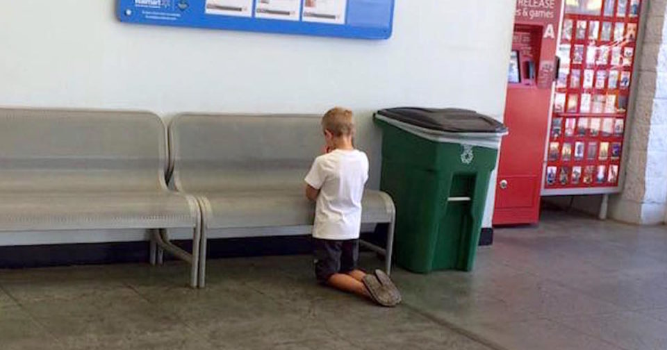 Mom find son kneeling to pray inside Walmart because of the sign on the wall
