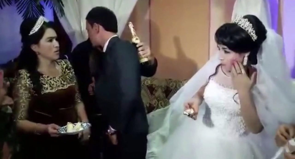 Groom slaps his bride in front of guests for not feeding him wedding cake